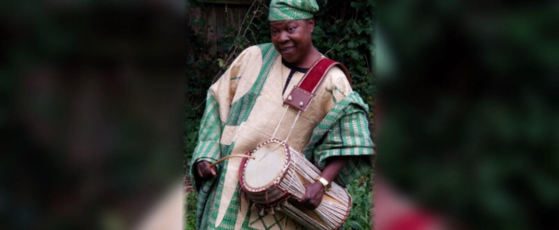 African Drummer playing the djembe
