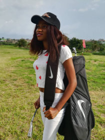 girl holding a bag and golf
