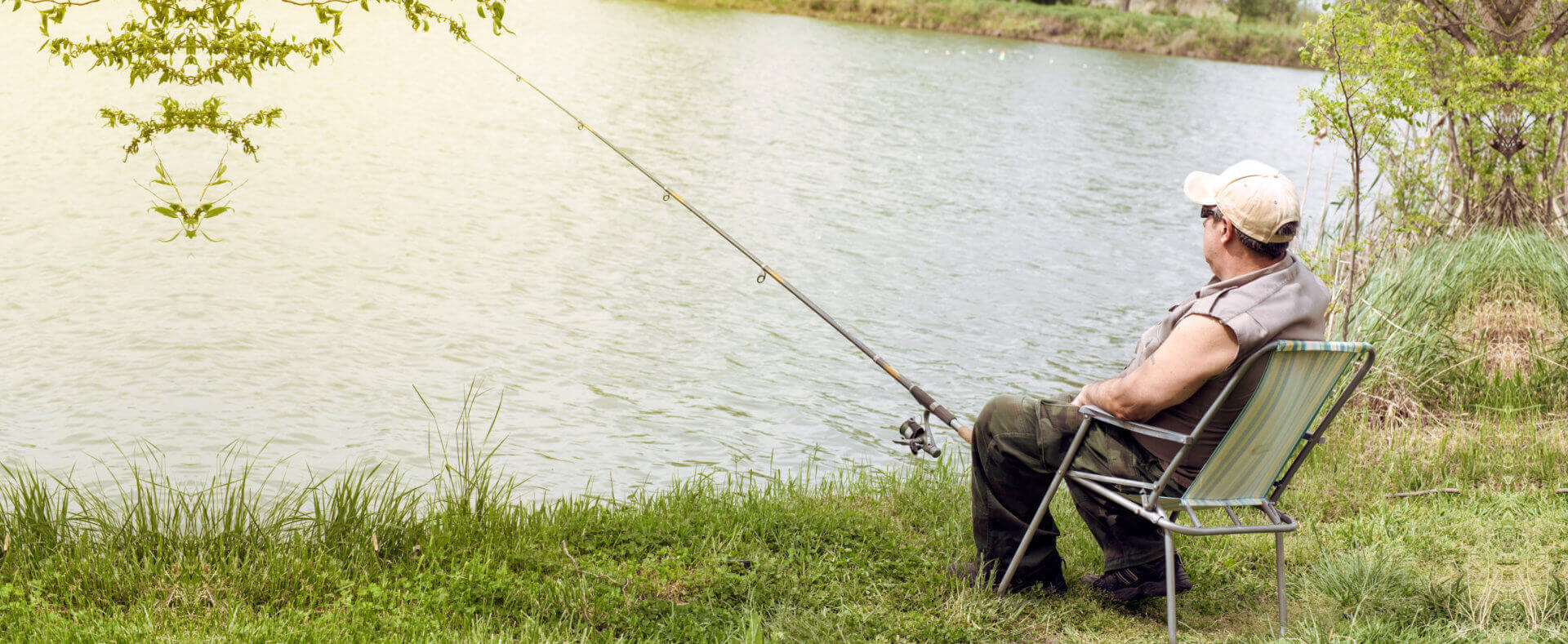 Senior man fishing by the lake